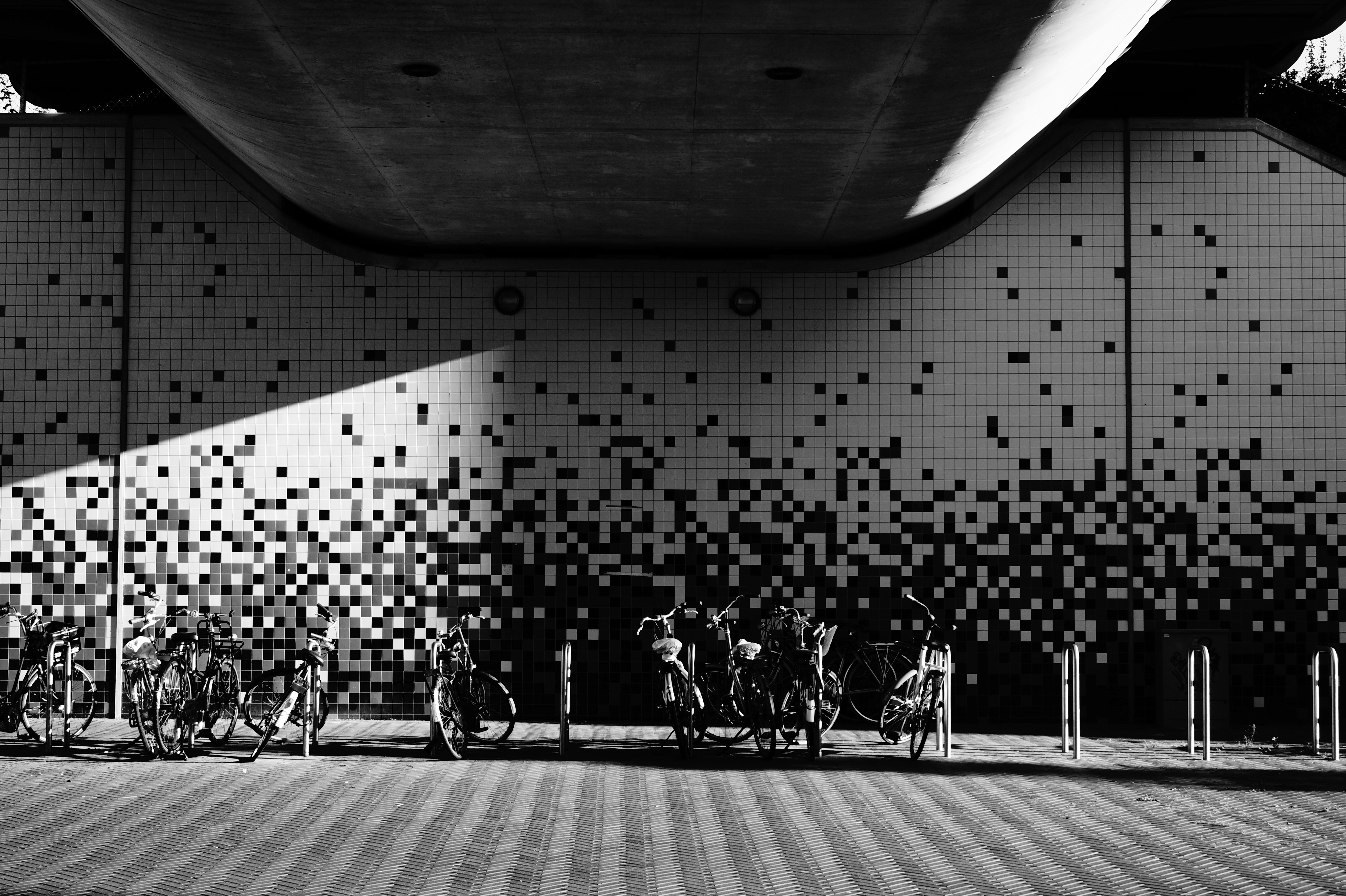 bike racks with black and white tiled walls